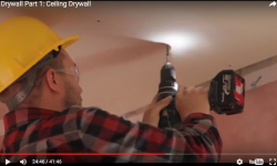 Train-volunteers-hang-drywall.png