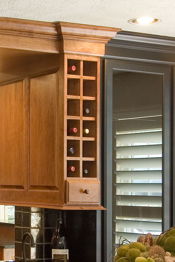 The Black Lines Are Visible In The Crown Molding And The Base Molding Of  These Upper Cabinets.